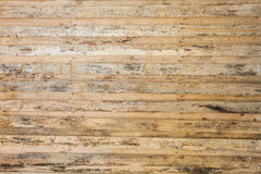 The texture of the wall made of wooden planks located horizontally, the surface of the wood is poorly treated, many wood fibers an Royalty Free Stock Photography