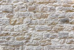 Medieval stone wall. Texture of wall. Medieval wall made from bumpy stones stock photo