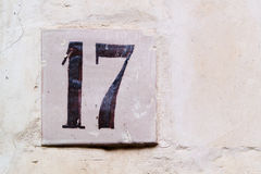 Texture of a wall with number 17 Royalty Free Stock Photo