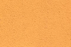 Texture of a wall orange. Background porous stock photos