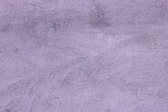 The texture of the wall painting in beautiful lilac tones. Shot close up stock photo