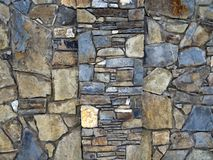The texture of the wall paved with stone royalty free stock photos