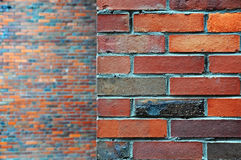Texture of wall of red  bricks. Texture of wall of red, black, brown different bricks. Blurred wall in the background Stock Photo