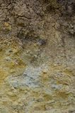 Texture of a wall of solid yellow and brown sand in a sandy quarr. Y Stock Photography