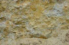 Texture of a wall of solid yellow and brown sand in a sandy quarr. Y Stock Images