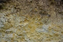 Texture of a wall of solid yellow and brown sand in a sandy quarr. Y Stock Photo