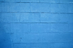 Texture wall of stone blocks, painted with blue paint Royalty Free Stock Photo