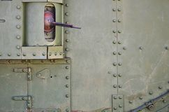 The texture of the wall of the tank, made of metal and reinforced with a multitude of bolts and rivets. Images of the covering of. A combat vehicle from the stock photo