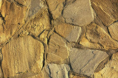 Stone wall pattern image,stone wall pattern picture,  masonry, stone wall pattern viewing, texture, wallpaper. Wall covering with natural stones cut and of Royalty Free Stock Image