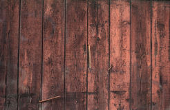 Texture of the walls of boards, painted with red paint Stock Photos