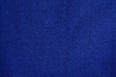 Texture of warm blue knitted winter clothes. royalty free stock photos