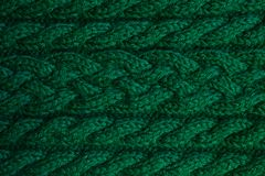 Texture of warm green knitted winter clothes. royalty free stock photo