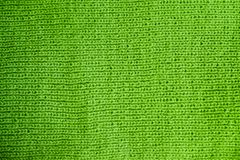 Texture of warm green knitted winter clothes. stock photos