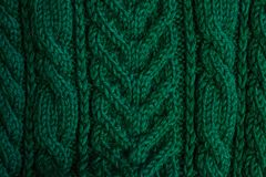Texture of warm green knitted winter clothes. stock photography