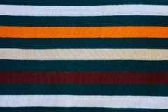 Texture of warm knitted striped clothes stock photos