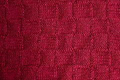 Texture of warm red knitted winter clothes. royalty free stock photos