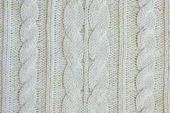 Texture of warm white knitted winter clothes. royalty free stock photography