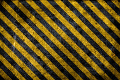 Texture warning hazard Background. Black and yellow striped grunge warning hazard construction background Stock Photography
