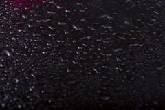 Texture of water droplets on black reflective Stock Photos