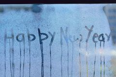 Texture of water droplets on clear window glass. With Happy New Year text Royalty Free Stock Images