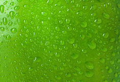 Texture water drops on the apple Royalty Free Stock Photos