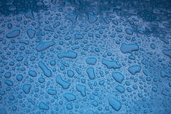 Texture - water drops on a blue body of the car. At day lighting Royalty Free Stock Image
