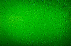 Texture water drops on the bottle of beer Stock Images