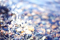Texture water pebble beach Stock Images