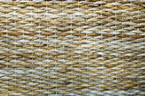 Texture of wattled straw. Texture of woven reed basket of beige color Stock Photo