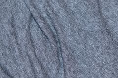 A wavy surface of a blue-gray wool knitted fabric as a background Royalty Free Stock Images