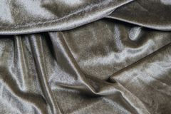 Texture of a wavy surface of a khaki velour fabric. As a background Royalty Free Stock Photos