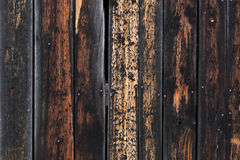 Texture of weathered wooden planks burnt on edges Stock Images