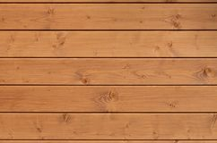 The texture of weathered wooden wall. Aged wooden plank fence of horizontal flat board. S Stock Photography