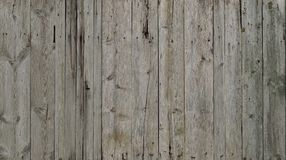 The texture of weathered wooden wall. Aged wooden plank fence of vertical flat board. S royalty free stock images