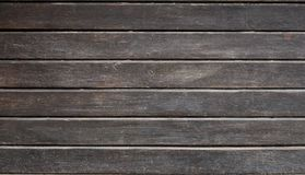 The texture of weathered wooden wall. Aged wooden plank fence of horizontal flat board. S royalty free stock photos