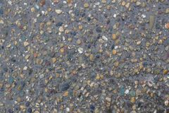 Texture of wet asphalt. Structure of wet asphalt with stones Royalty Free Stock Photo