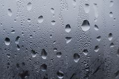 Texture of wet drops on the glass. thaw stock images