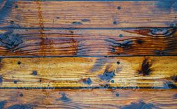 The texture on the wet planks of the wooden pine deck.  stock photo