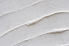 Texture with white cement. And plaster bas relief lines and spatula Stock Photography
