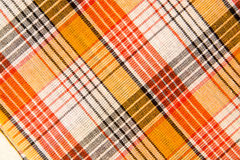 The texture of white checkered, orange, red, black cotton fabric Royalty Free Stock Photos