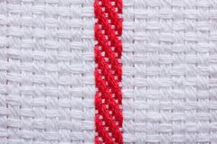 Texture of white cotton kitchen towel with a red stripe. Macro. Royalty Free Stock Images