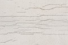 Texture of white dirty cracked wall. Small straight cracks. Direct fracture on painted surface. Cells block fissure. Texture of white dirty cracked wall. Small royalty free stock image