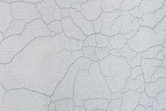 Texture of white dirty cracked wall. Small straight cracks. Direct fracture on painted surface. Cells fissure.  Royalty Free Stock Photography
