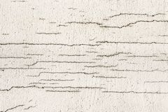 Texture of white dirty cracked wall. Small straight cracks. Direct fracture on painted surface. Cells fissure.  stock photos