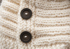 Texture of white knitted soft sweater with buttons Royalty Free Stock Photo