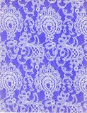 Texture White Lace Pattern Purple Background. Feminine white Lace detail for background texture. Background is purple Stock Photos
