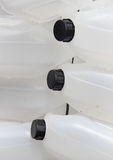 Texture of white plastic jerrycans Royalty Free Stock Photography