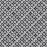 Texture of white rhombus on a gray background Stock Images