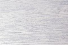 Texture of white rustic wooden table background. In the rays of light royalty free stock photo