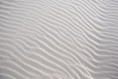 Texture on the white sand. Windy pattern on the white sand on the desert Stock Photography